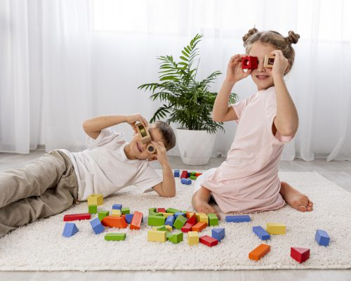 Non Binary Kids Playing With Colorful Game