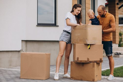Young Family With Little Daughter Moving Into New House